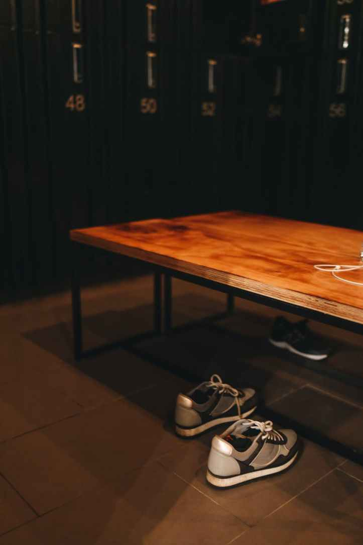 sneakers under a wooden bench
